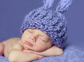 Photo nouveau-ne Photo de b�b� endormi avec bonnet de lapin