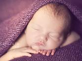Photo nouveau-ne Photo de bébé dans une couverture