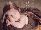 Photo nouveau-ne Photo de bébé dans sa corbeille en osier