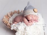 Photo nouveau-ne Photo de bébé tête appuyée sur la corbeille