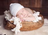 Photo nouveau-ne Photographie studio de bébé dans sa coquille
