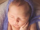 Photo nouveau-ne Photographe de nouveau-né en sécurité