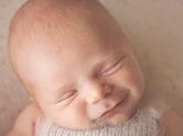 Photo nouveau-ne Sourire de bébé
