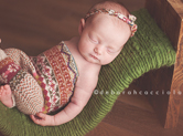 Photo nouveau-ne Photo de nouveau-né avec accessoires